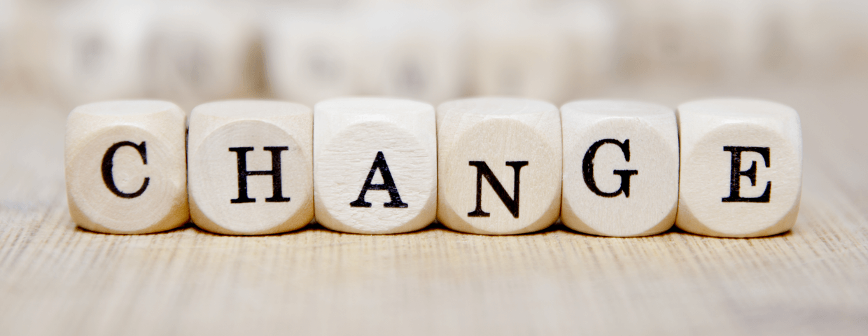 Wooden blocks that spell out the word change on a table