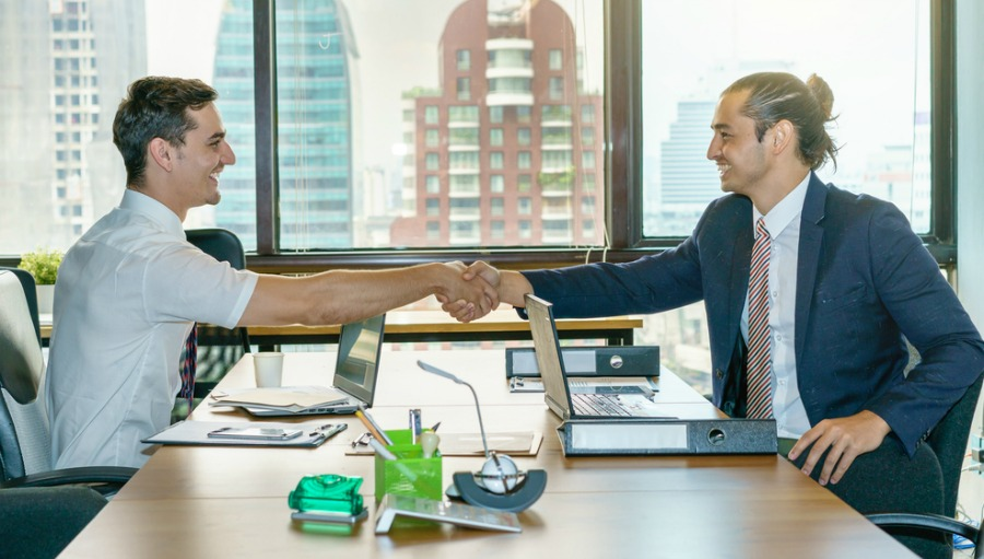 Two Men in an Office Shaking Hands