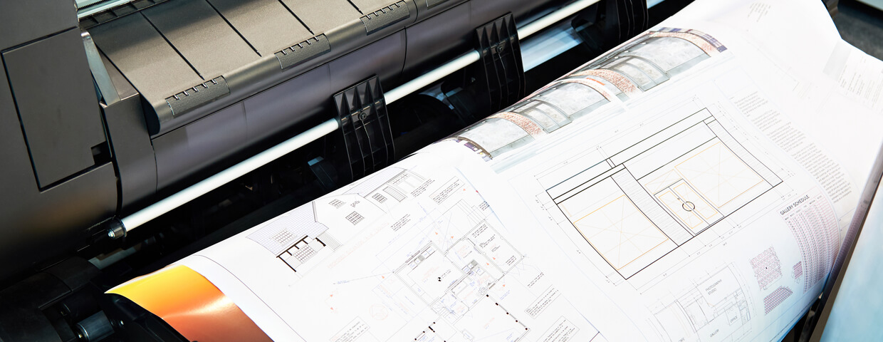 Printer printing colored paper as well as floor plans