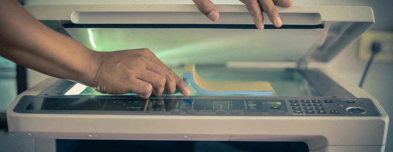 Scanning paper document on machine.